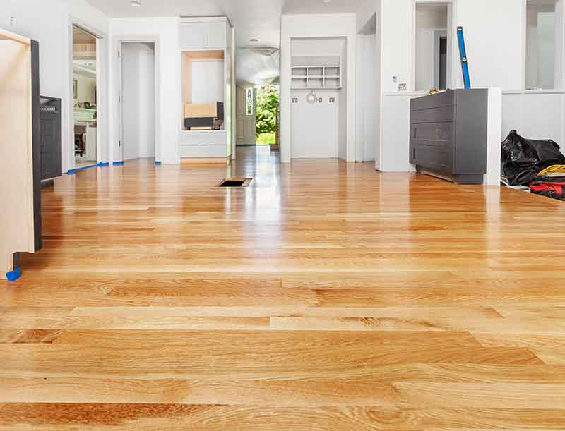 Remodeled kitchen has existing hardwood floor patched