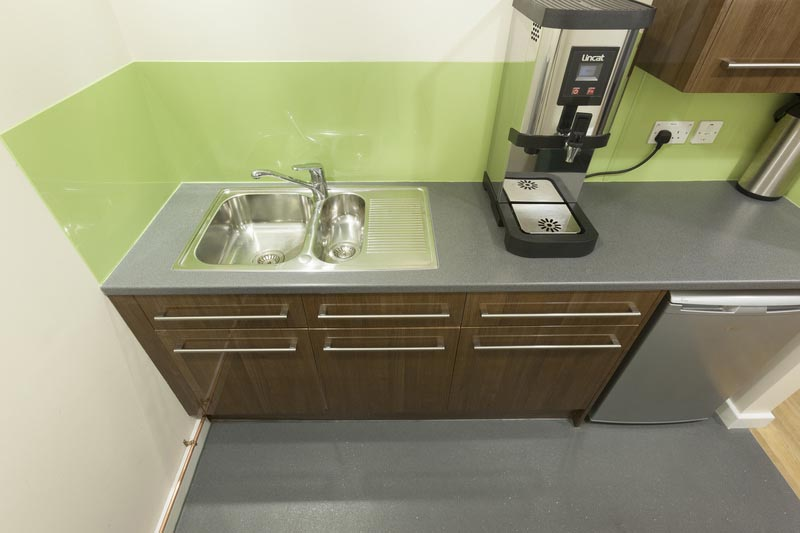 green and silver kitchen